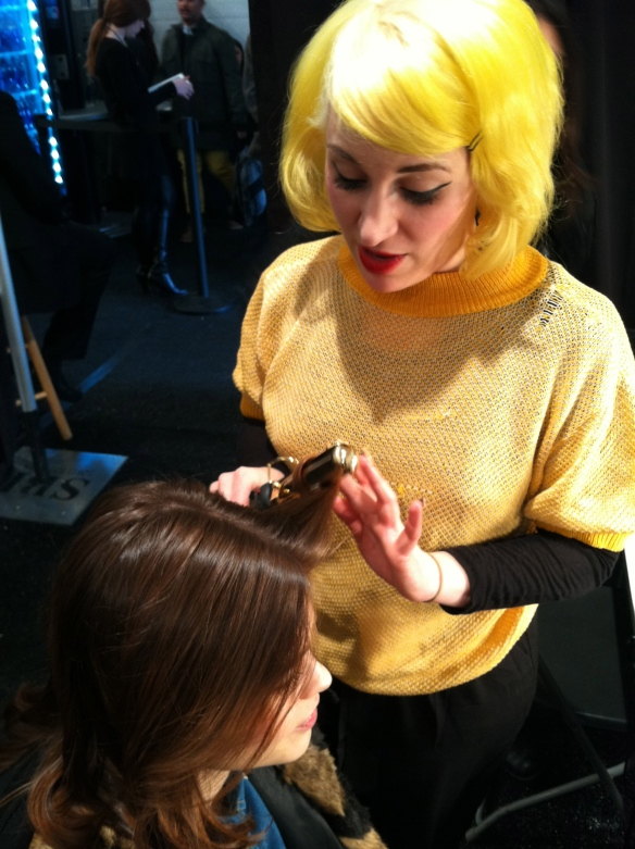Backstage, love this hair stylist's yellow, cotton candy hair.
