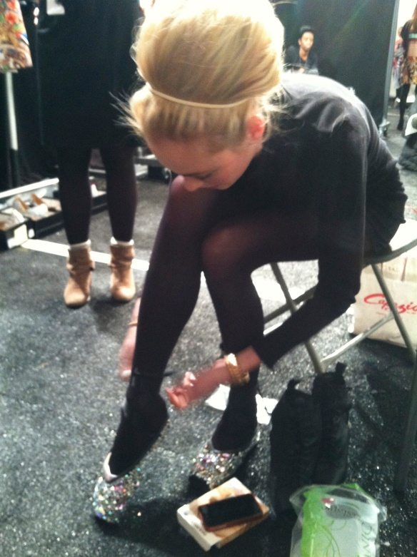 Shannon trying on her ballet flats before the show, it had been awhile since she had danced and was nervous.